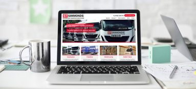 Laptop with Simmonds Transport website