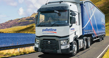 Palletline vehicle driving on a country road