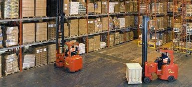 Simmonds Transport warehouse with forklift drivers removing pallets